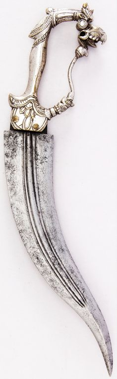 Indian (Thanjavur, Tamil Nadu) Bichuwa dagger, 17th century, steel, brass, silver, H. 10 5/8 in. (27 cm); H. of blade 7 1/2 in. (19.1 cm); W. 2 11/16 in. (6.8 cm); Wt. 8.1 oz. (229.6 g) Bequest of George C. Stone, 1935, Met Museum.