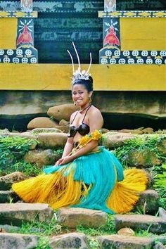 A young Palauan woman sitting in front of the Abai (men's meeting house) showcasing her clan's traditional women's wear. Photo by Kenny G. Reklai.