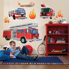 "Fire Trucks Giant Wall Decals Decals are made of vinyl and are for use on smooth, flat surfaces. Includes 1 large firetruck (44"" wide x 26"" high), 2 smaller fire trucks, 6 flames, ""Fire Trucks"" logo,"