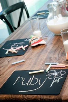LOVE! Dollar Store placemats spray painted with chalkboard paint. So simple
