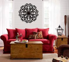 Red couch in a neutral living room