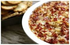 Crockpot Groovin' Ruben Dip       • 8 oz. cooked corned beef, coarsely chopped     • 1 C Kraut, rinsed/drained/chopped     • 8 oz. Cream Cheese - softened  • 1/2 C Thousand Island dressing  • 2 cups shredded Swiss Cheese     Directions:    Mix all ingredients in 1-1/2 - 3 quart crock pot.   Cover & cook on low for 4 hours.  Serve with party rye, pretzels, pickles, or French Bread cubes.