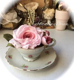 Beautiful tea cup, decorated with true handmade fabric flowers. H - 4 with flowers, 5 - W saucer. Two roses and rose buds were made by me petal by petal. They look very realistic and soft on touch. This tea cup will be absolutely gorgeous as a decor for Tea party or any other occasions . Thank you for stoping by