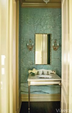 small bathroom, powder room, chinoiserie wallpaper, sconces flanking mirror over sink, veranda magazine, small bathroom