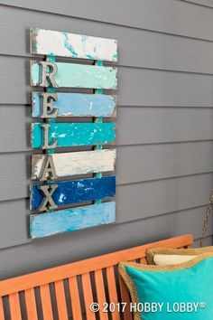 Freshen up your home decor with paint! For this look: stain raw wood, add layers of FolkArt Coastal Paint (letting each dry before adding another), and then sand away areas to distress wood and reveal colors. Arte Pallet, Pallet Art, Pallet Painting, Coastal Paint, Coastal Decor, Nautical Decor Outdoor, Outdoor Wall Art, Coastal Style, Beach House Decor
