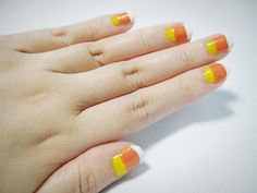 Love these candy corn nails.