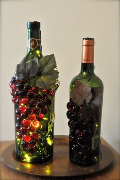 You just get some red glass beads and glue 2 layers on with hot glue. Glue some ivy leaves from a silk ivy bush on for the leaves. Then stuff a 10 light set into the bottle and get some twine to wrap around the top to hold the cord down. You can leave the bottle lit for years. I never turn mine off and have only replaced the lights once in 6 years. ~ I read glass gets hot from lights. Use LED or Epoxy glue instead of hot glue.