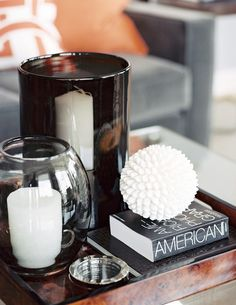 The Perfect Vignette: Vary the texture by mixing polished and hard-surface accessories with rough and textured ones.