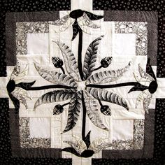 Free Pattern:  Coneflower applique pattern by Laura Conowitch at LC's Cottage. The original design was created for a raffle quilt for the Washington State Quilters-Spokane Chapter.