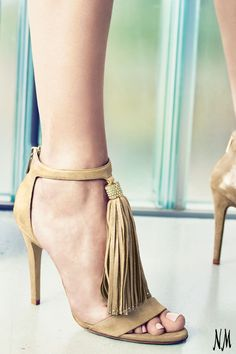 A tasseled sandal by Jimmy Choo is your new sophisticated shoe. With shimmery suede and a simple ankle strap, you will feel elegant all evening.