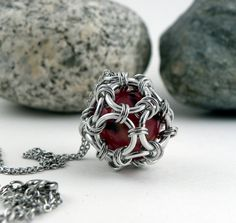 Hey, I found this really awesome Etsy listing at https://www.etsy.com/listing/183539081/caged-marble-chainmaille-pendant-with