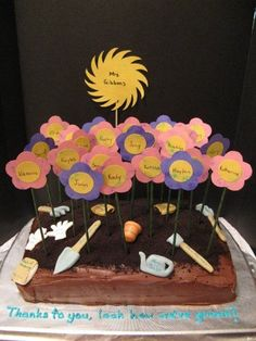 A Kinder-Garden Graduation - cake for my daughter's kindergarten graduation. the names of the principal, librarian, secretary, educational assistants, regular parent volunteers (adults that worked with the students this year) are on the garden growing implements. the teacher is the sun, students are the flowers.