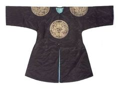 A black satin ground surcoat with embroidered dragon roundels (gunfu). Late Qing Dynasty. Photo Bonhams