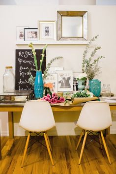 Beautiful flowers & white Eames chairs