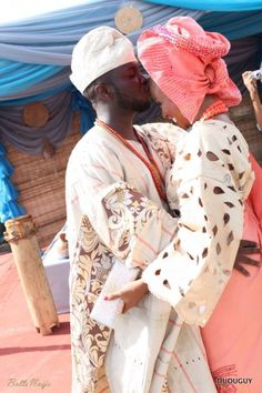 Aso Oke - is the hand woven cloth of the Yoruba speaking people of the South West of Nigeria. The Bride and Groom are wearing an elegant aso oke ensemble