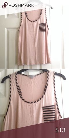 CR tank top Racerback tank with striped pocket and striped detail around neck and arms. Seems like a very light of pink and tan mix.  💸 Reasonable offers considered.  ↘️ Use OFFER button.   🚫 NO TRADES! ⚡️Fast Shipper! Charlotte Russe Tops Tank Tops