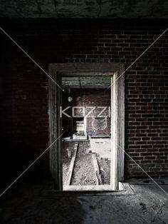 doorway and a brick wall. - Image of old doorway and a brick wall.