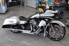 "2012 Road Glide CVO: White Gold Pearl/Starfire Black with smoke graphics, Renegade 23"" matching Harley Agitator contrast cut wheel, Renegade Matching Agitator Rotors, Yaffe Classic 23"" Stretched Fender, Pickard 6 deg triple tree & lowering kit; 2 brothers 8"" Apers; Soundstream 500 watt amp with 6.5"" Fairing speaker, front fairing 250 watt tweeters & 6.5 lower fairing speakers, Burly 10.5 rear coil over shocks, Yaffe Skoowl trim"