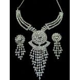 Stylish Sparkling Stones Studded Necklace Set. This set is made up of Semi Precious Stones Studded with Earings..