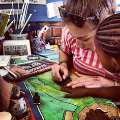 Volunteer Alex putting on nail polish for a student in South Africa via @Dan Le Van