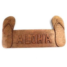 ALOHA welcome sign with two slippers on each side. Sign has been hand carved and measures 15 inches by 8 inches. Comes ready to hang. Spread some ALOHA!