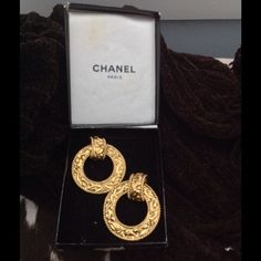 Chanel vintage door knocker earrings Gold vintage Chanel door knocker earrings. Hoop can be removed and small portion can be worn alone. Clip back. CC logo is at the top of the small clip portion. I am the original owner. Original box is included ( box is in OK but not great shape). Earrings are in excellent shape. CHANEL Jewelry Earrings