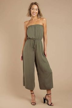 Dressing up is a breeze in the Sounds So Easy Olive Strapless Jumpsuit. This beach jumpsuit features a strapless neckline, fitted waist with a front t Beach Jumpsuits, Jumpsuits For Women, Black Strapless Jumpsuit, Strapless Dress, Olive Shorts, Green Shorts, Olive Jumpsuit, White Lace Romper, Jumpsuit Outfit