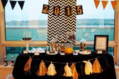 Black and gold dessert table at a 2015 New Year's party! See more party planning ideas at CatchMyParty.com!