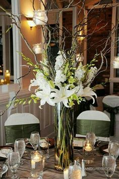 gorgeous centerpiece, featuring white Casablanca lilies, white stock, green dendrobium orchid sprays and curly willow branches with hanging votive candles Curly Willow Centerpieces, Tall Wedding Centerpieces, Flower Centerpieces, Wedding Decorations, Tall Centerpiece, Manzanita Centerpiece, Floral Wedding, Wedding Bouquets, Wedding Flowers
