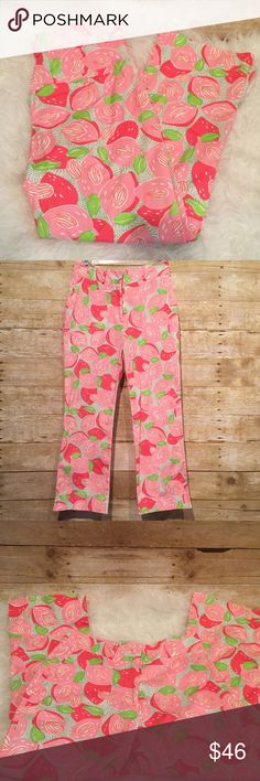 "Lilly Pulitzer Pink Mango Print Capri Crop Pants 2 Cropped pants feature a retired, white label Mango Momma pattern of mangos and leaves done in pinks, green and white. Single pocket at back is secured with a Lilly logo'd button. Inseam is approximately 24"" and rise is 9.5"". Lilly Pulitzer Pants Ankle & Cropped"