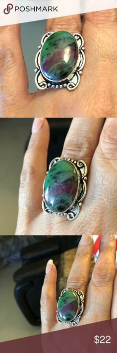 Ring.  Ruby Zoisite Gemstone On .925 Silver Size 9 Ring Ring.  Ruby Zoisite Gemstone On .925 Silver Size 9  Beautiful Gemstone, unique cut design that shows a streak of Ruby Gemstone. Jewelry Rings