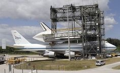 shuttle discovery being placed on a jumbo jet to be flown to the udvar-hazy center in virginia