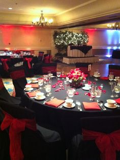 Black and Red Wedding.  Sweetheart table with Christmas light trees as a backdrop!