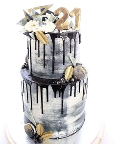 BLACK BEAUTY | A black and white number with hints of gold for a special 21st birthday celebration. Layers of white-choc raspberry layers paired with salted caramel Swiss meringue buttercream. All topped with marbled chocolate pieces, macarons, blueberries and a gold edible chocolate topper. Happy birthday Bella!