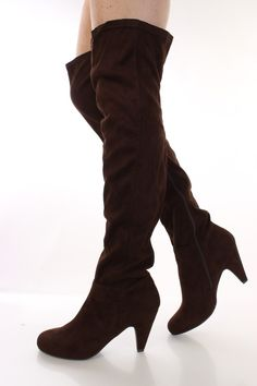 Make a fashion statement with these sexy thigh high boots! They will look super hot paired with your favorite skinnies or dress. Make sure you add these to your closet, it definitely is a must have! These boots features round close toe, faux suede, stitched detailing, side inner zipper, smooth lining, and cushioned footbed. Approximately 3 1/4 inch heel, 22 inch shaft and 15 1/2 inch circumferences.