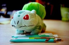 We posted on Instagram: Bulbasaur hasn't found any Pikachu with party hats yet so he's picking out matching pens and pencils instead. #pokemonday #pokemon #bulbasaur