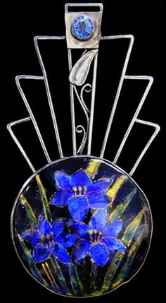 GEORGE HUNT (1892-1960) A silver brooch set with an enamel of blue flowers