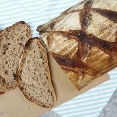 The next Sourdough loaf out of the oven! Experimenting with scoring and shaping. This wholewheat  version has the best crumb till date. Lo vuoi imparare anche tu? Prenoti il tuo corso di pane con me! In Como town, book your bread cooking course with me now! #bread #loaf #sourdough #crust #baking #levain #naturalleaven #foodblog #food #feedfeed #f52grams #dolci #breadlove #organic #como #pasticceria #bakery #catering #cakestagram #cake #lagodicomo #artisanbread #panificio #realbread…