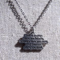 "Pewter A.A. Milne Winnie the Pooh Quote Charm Necklace ""You're Braver Than You Believe, Stronger Than You Seem, and Smarter Than You Think"". $24.00, via Etsy."