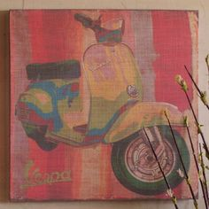 Linen wrapped canvas wall art with a yellow Vespa motif.   Product: Wall artConstruction Material: Linen and wood