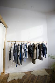 Hanging Branch, wood hangers, clothing rack with sheep hides (from the sheep counted?)