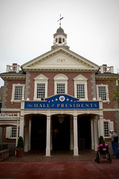 "Things You Probably Didn't Know About Disney Parks 13. If you look closely at the second-story windows near the ""Hall of Presidents,"" you'll see two lanterns. They are referencing the line ""One if by land, and two if by sea"" from Henry Wadsworth Longfellow's poem ""Paul Revere's Ride."""