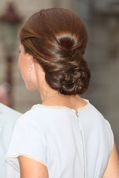 Dutch Braided Updo From The Duchess of Cambridge | This breathtaking updo from the British style icon Kate Middleton is made from a rolled inside-out braid and 4 front hair sections, wrapped around it and secured inside.