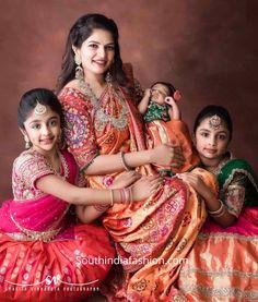 Viranica Manchu and her kids in traditional outfits at a wedding – KinderMode