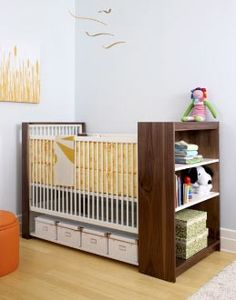 """Smart idea.... A bookcase built into the end of a crib!... """"Extra, Extra"""" --- stylish storage beneath.... Just don't know if the storage part can be done/gotten now.... cribs are so close to the floor these days!"""