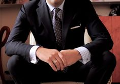 French cuffs on a gingham shirt with a slim-cut suit and pocket square.