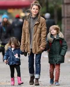 Follow the leader: Kerri Russell led her children on an outing to pick up bagels for break...