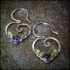 Earrings Handmade Amethyst and peridot wire wrapped onto sterling silver ear wires. Handmade earrings by Gypsy Lotus - Amethyst and peridot wire wrapped onto sterling silver ear wires. Handmade earrings by Gypsy Lotus Length= inches Width= inches Wire Wrapped Earrings, Wire Earrings, Earrings Handmade, Handmade Jewelry, Metal Jewelry, Beaded Jewelry, Silver Jewelry, Jewellery Uk, Jewelry Shop