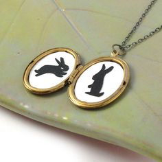 Paper Cut Bunny Silhouettes in a Vintage Locket by sugarcookie, $28.00