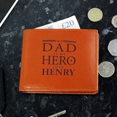 Personalise this leather wallet, with a name up to 12 characters.The text 'My Dad is My Hero, love' is fixed and will appear as standard on the wallet.Wallet includes a Change Holder, 6 Card Slots & Notes Holder.Material is leather.Ideal for B. Personalized Leather Wallet, Personalized Fathers Day Gifts, Personalized Christmas Gifts, Gifts For Dad, Family Gifts, Boyfriend Anniversary Gifts, Boyfriend Gifts, Brown Leather Wallet, Tan Leather